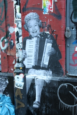 Her Majesty the Queen, sitting on a wall... playing the accordian!