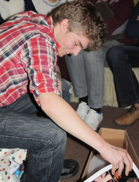 Having just opened one of his 18th birthday presents... all smiles because he got the guitar he wanted that I'd been telling him he wasn't getting because it was too expensive!
