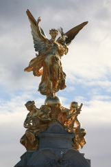 The gold figures on top of the Victoria memorial opposite Buckingham Palace